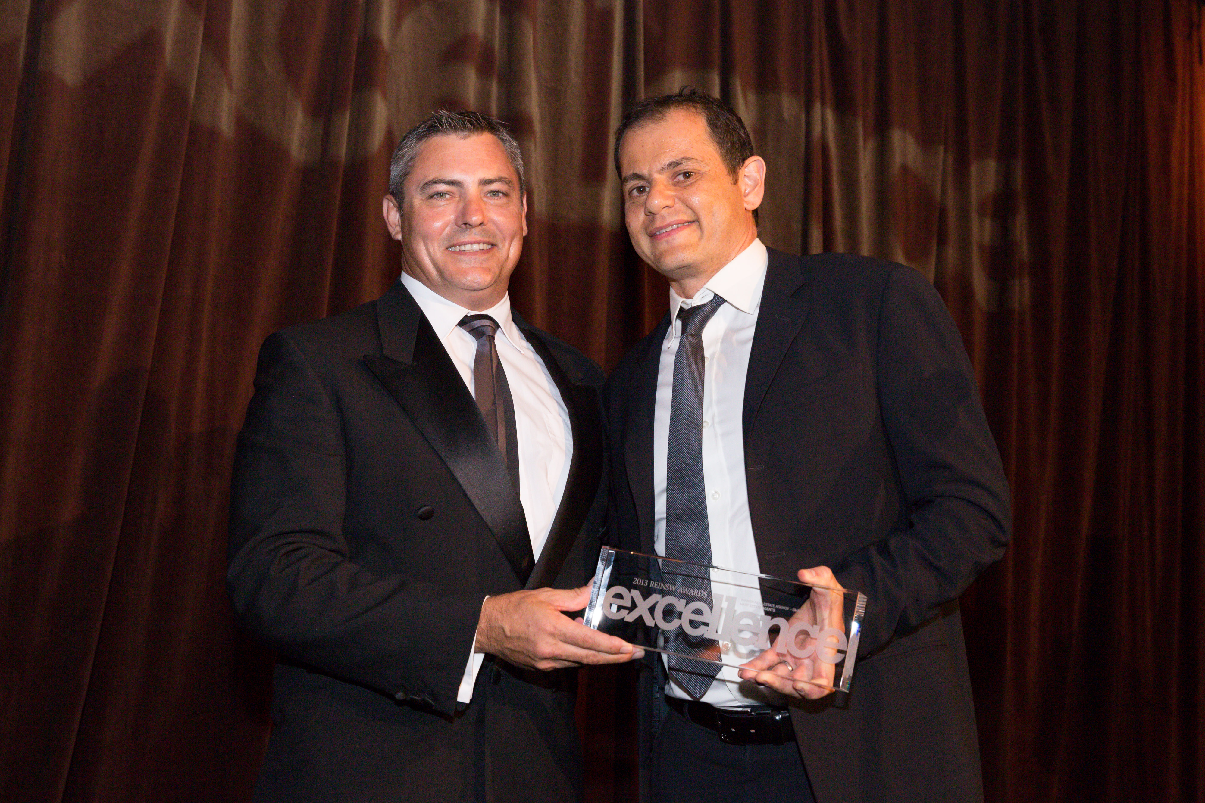 ALex Hart receiving our award for Real Estate Agency (Small) at the REINSW Excellence Awards 2013